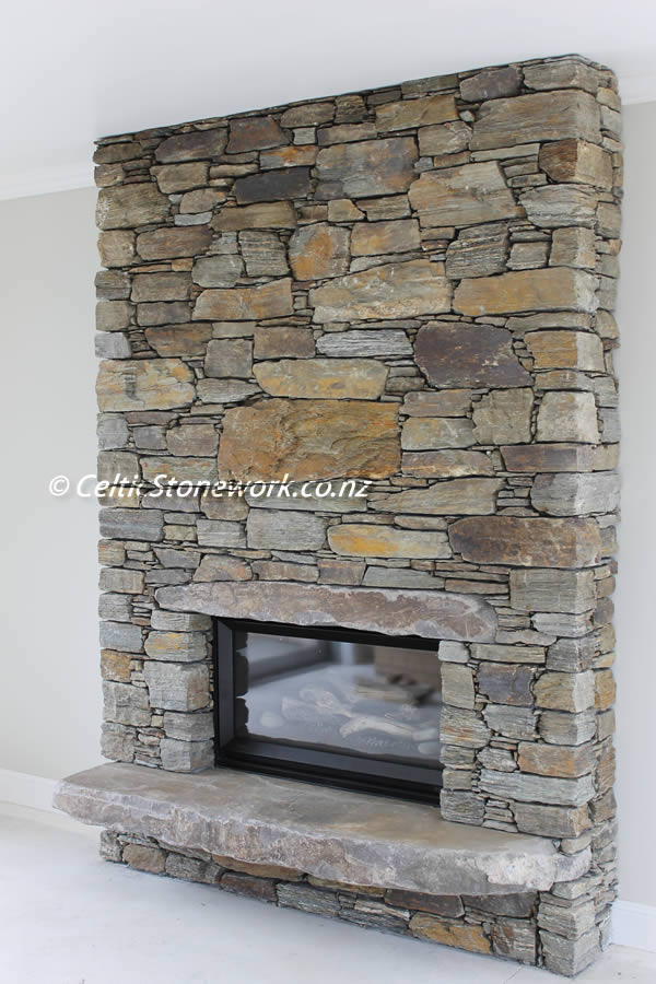Stone Fire box with floating hearth and Andesite Lintel