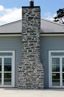 Gibston grey Chimney with flush antique white pointing. Location Scott Road Horahora Karapiro