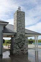 External Chimney using Dennison grey schist with a Farm house style finish Karapiro