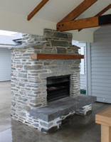 External fire place using Dennison grey schist with a farm house style finish - Karapiro